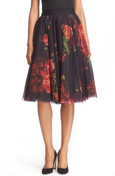 Currently crushing on this floral printed midi skirt by Ted Baker. This full and flirty piece gathers at the waistband to create a slimming silhouette.