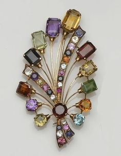 A vari gem-set spray brooch                                                                                                                                                                                 More