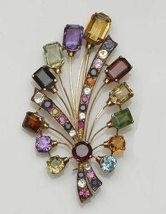 A vari gem-set spray brooch