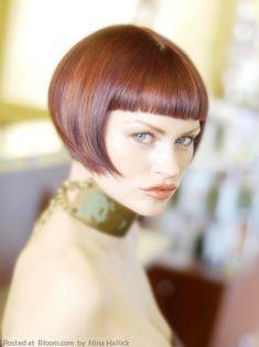 A very modern short hair cut with straight bangs.    By Nina Hallick