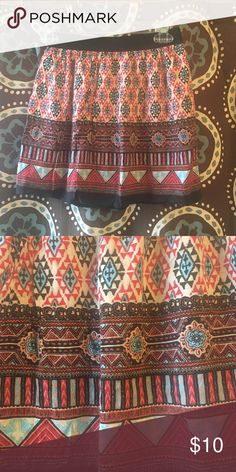Tribal Print Skirt Very cute elastic waist Aztec inspired print skirt.  Lined, size small, in great condition Skirts Mini