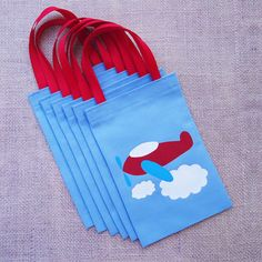 Airplane Favor Bags : Set of 6 Propeller Airplane Party Goodie Bags. $22.50, via Etsy.