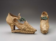 """1670, Europe - Pair of women's """"slap-sole"""" shoes - Leather, silk satin with straw applique, silk laces and tassels, leather lining and sole"""