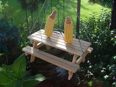 Picnic table squirrel feeder by allaboutwood01 on Etsy, $17.00    @Sarah Paige is this excessive for Kevin??
