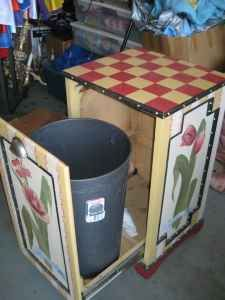 wood filing cabinet-made into a trash can recepticle!