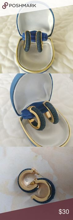 Joan Rivers Pierced Earrings Gold Tone  Navy Blue Joan Rivers Pierced Earrings Gold Tone  Navy Blue Nice Joan Rivers half hoop earrings gold tone fabric blue,in good condition. Please,consider photos as part of the description. Joan Rivers Jewelry Earrings