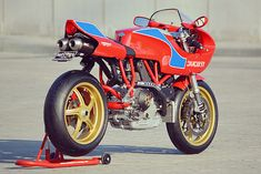 """It was the result of three great forces combining to build a beloved motorcycle that tugged at the heart-strings of the Ducatisti around the globe. The legendary feats of Mike """"the Bike"""" Hailwood, the brilliance of head Ducati Designer Pierre Terblanche and the global power of a relatively new communications tool for the masses, the internet. The result was the limited run Ducati..."""
