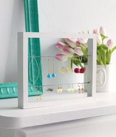 Earring organizer - put a back on it with either scrapbook paper or small print fabric to finish it off.