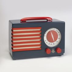 The Patriot radio was designed by noted industrial designer Norman Bel Geddes and manufactured by the Emerson Radio and Phonograph Corporation in 1939. The radio is made from Catalin, a thermoplastic similar to Bakelite, which came into widespread use in the 1930s.