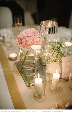 Minimal flowers on mirror with candles.  Modern, simple and elegant