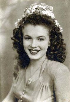 Norma Jeane Mortenson (even without her blonde hair, bombshell boobs, new nose and chin, she was gorgeous :)