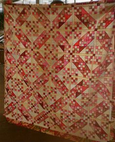 Pink Jacob's Ladder Quilt. Nine Patches in a simple setting that changes everything!