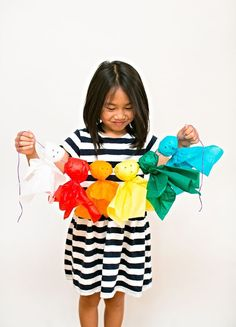 DIY Rainbow Tissue Ghost Garland. Who says all ghosts have to be white? Find out how to make these easy and colorful tissue paper ghosts!