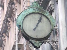 """Clock outside the Nathaniel Fisher Company, wholesale shoe dealers described in an 1894 New York Times article as one of """"the oldest shoe firms in America."""