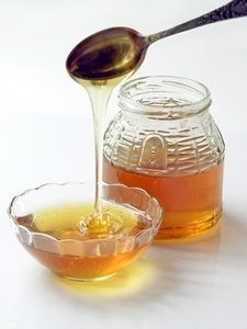 1) Use 3/4 c honey plus 1 Tb for every cup sugar. 2) If the recipe does not include buttermilk or sour cream, add 1/4 tsp baking soda for each cup of sugar being replaced. 3) Reduce the recipe's liquid ingredients by 1/4-1/2 c for each cup of sugar being replaced. If no liquid is called for, add 1/4 c flour. 4) Bake the item at 25 degrees lower than the recipe calls for.