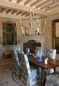 Beautiful blue and white slip covers for dining room chairs.