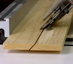 Making a French Cleat. Start by marking a centerline across the thickness on the end of a board. Then mark a line bisecting this centerline, as you see here. Line up this mark with the blade of the saw. by Chris Hill Diy Garage Storage, Storage Ideas, French Cleat, Workbench Plans, Workbench Stool, Shop Organization, Workbench Organization, Organizing, Wood Plans