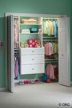 An adorable little girl's closet complete with triple-hung clothes which can be converted as she grows.  Available from Organized Hawaii.