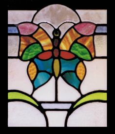 Truly unique and visually captivating, this vibrant vintage stained glass window featuring a butterfly is a reminder of the simplicity and beauty of nature.