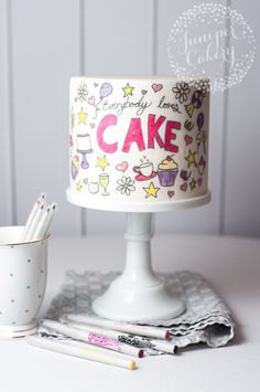 Need a bright, festive cake in a hurry? Don't stress — make a doodle cake! After icing a simple cake in fondant, simple draw illustrations and phrases in edible ink. Get our top tips for a fail-proof doodle cake right here. Cute Cakes, Pretty Cakes, Beautiful Cakes, Fondant Cakes, Cupcake Cakes, Buttercream Cake, How To Make Doodle, Doodle Cake, Bolo Moana
