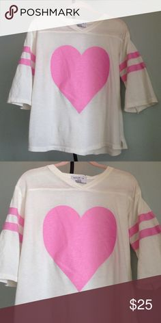 "NWOT WILDFOX KIDS Heart Tee Details - Pink heart in center with pink stripes on sleeves - Side Vents - Size 7/8 (Girls) -  Approx. 19"" from Top to Bottom of Hem, 17"" pit to pit - NWOT, Made in USA  Fiber Content: 100% Cotton (Tissue Feel) Wildfix Kids Tops Tees - Short Sleeve"