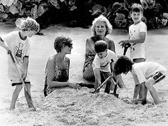 LIFE'S A BEACH It's a sandy pile-up for Diana as she gets in on the fun with Wills, 7, and Harry, 5, and her nephews during a 1990 New Year's getaway with her mother, Frances Shand-Kydd, on Necker Island, Sir Richard Branson's private hideaway in the British Virgin Islands