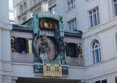 This photo shows the Anker Clock of Vienna. The Time right now is 11:29 A.M.