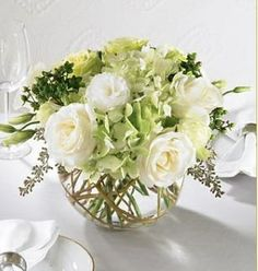 beautiful centerpieces. blush and white peonies instead of roses.
