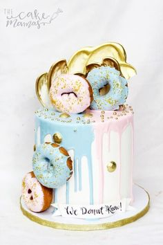 Donut Gender Reveal Cake! Call or email to place your special orders today! #donuts #genderreveal #girlorboy #dripcake #blue #pink #gold #fondant #chocolate #cake