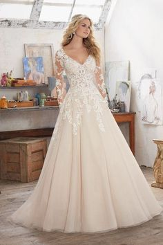Romantic wedding dress idea - lace bodice with illusion, lace sleeves and tulle skirt. Style 8110 by @morileewedding.