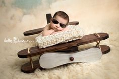 Newborn pilot boy in aviator sunglasses airplane prop | Bella Rose Portraits Southern California San Diego County newborn and baby photographer photography posing techniques
