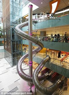 Slide at Changi, Singapore Airport - Wow! I would love to try this. What a great way to spend layover time.