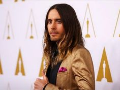 "Jared Leto flashes a ""thumbs up"" on the Oscar nominees luncheon red carpet"