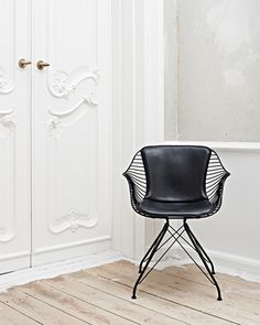 Modern Black Leather and Wire Dining Chair in Classic Room   Living Space