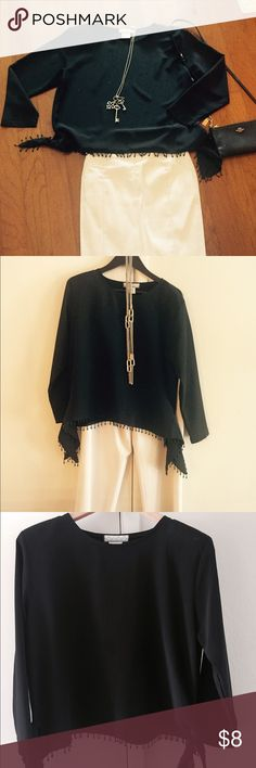 Dressy black top Snazzy black long sleeve blouse; Nino Wong brand; size small but can fit medium; boxy shape; 100% polyester; bottom fringe, cute side ties and small imbedded shoulder pads; perfect for special occasion or a night out. Nino Wong Tops Blouses