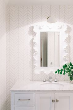 White bathroom with a bit of texture: http://www.stylemepretty.com/living/2015/08/28/nashville-home-tour/   Photography: Leslee Mitchell - http://lesleemitchell.com/