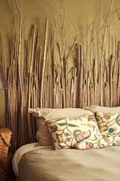 or what if you hung twigs on the whole wall horizontally... similar to this? ikea has twigs similar to this for cheap that you could buy...