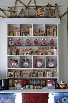 rubber stamp storage and display in a cute white cubby with shelves.  Personalize with cute letter blocks!
