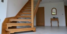 Contemporary oak stairacse with open risers and glass detail (Private Client. Location: Northern Ireland)