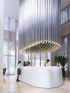 Perfect Studio M Hotel Reception In Singapore Has A Long Silver Ceiling Light  Fixtures. Interior Design Home Ideas