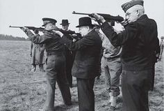General Dwight Eisenhower, Prime Minister Winston Churchill, and General Omar Bradley test fire the M1 Carbine (ca. 1943).
