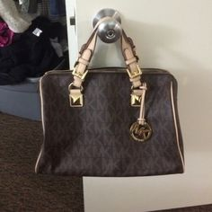 Michael Kors purse Gently used MK logo purse. Listed lower elsewhere. Email me for other info kharveston@gmail.com Michael Kors Bags Totes