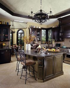 fancy country kitchen...think I will stain my cabinets darker...love this