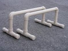 How to make your own parallettes out of PVC pipe - video. *Basic idea, would need to change the height
