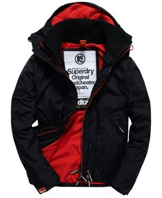 uperdry men's hooded Arctic windcheater. An essential jacket with hood and body fleece lining. This jacket also features triple-layer two-way zip fastening with coloured middle zip, vibrant hood and hem draw cords, two side pockets and ribbed cuffs with thumb holes. The Arctic Windcheater is finished with embroidered Superdry shoulder logos and a Superdry logo tab on the sleeve.