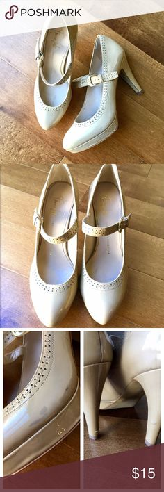 Nude Closed Toed Heels Classy closed toed patent leather heels in nude by Franco Sarto. Adjustable strap. Worn condition with a a couple scuffs on heels and small stain on side of shoe (shown in pictures.) Still beautiful shoes! Franco Sarto Shoes Heels
