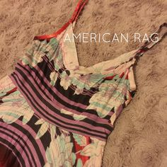 American Rag Spice Tandori Dress New With Tags American Rag Spice Tandori Dress. Spaghetti Strapped Hi-Low Dress with beautiful design. Size X-Small. I am size Small so this is a little snug on me. American Rag Dresses Asymmetrical