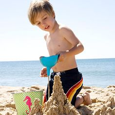 Drip Castle  Try this fun twist on a traditional sand castle. Fill a bucket with half sand and half water. Pour wet sand through a plastic funnel to build an abstract beach structure. Don't have a funnel? Cut the bottom off an empty two-liter bottle to make your own.