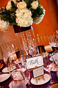 Meaningful table names add elegance to high or low centerpieces! Carmen Photography