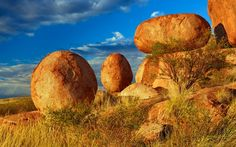 Frank Krahmer / Corbis Devils Marbles, Australia 20 of 28   Known to the Aborigines as a sacred place called Karlu Karlu, the Devils Marbles Conservation Reserve gives Ayers Rock some serious competition as the Northern Territory's most iconic site. Most photos focus on just two of the rocks, but there are actually many more of these prehistoric rust-colored granite boulders—some of which can be as large as 20 feet in diameter—strewn over an area of 4,400 acres.